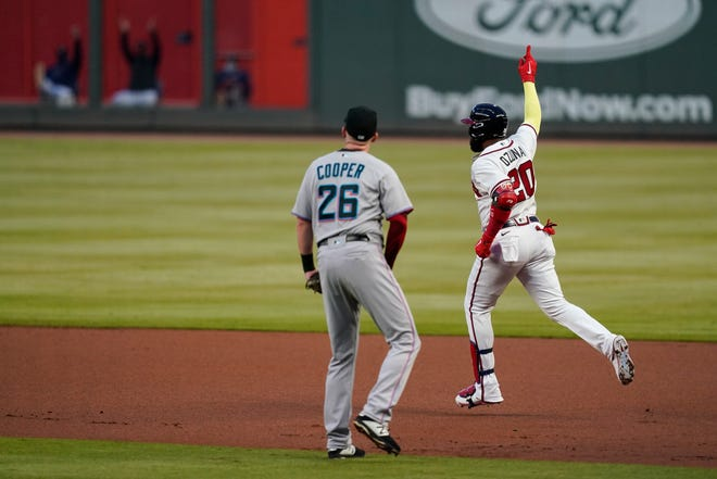 Atlanta's Marcell Ozuna celebrates after hitting a solo home run against Miami on Tuesday.