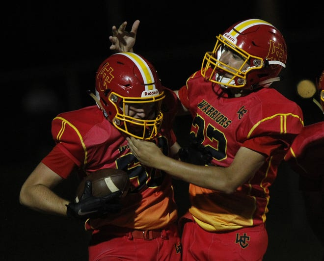 Worthington Christian's Jax Hollister is congratulated by Andrew Garner after returning a kickoff for a touchdown Sept. 10 against Fisher Catholic.