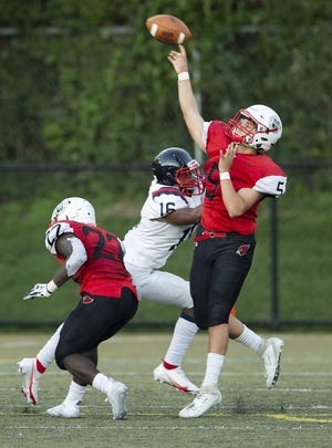 St. Charles quarterback Carter Bryant throws a deep pass against Hartley on Sept. 18.