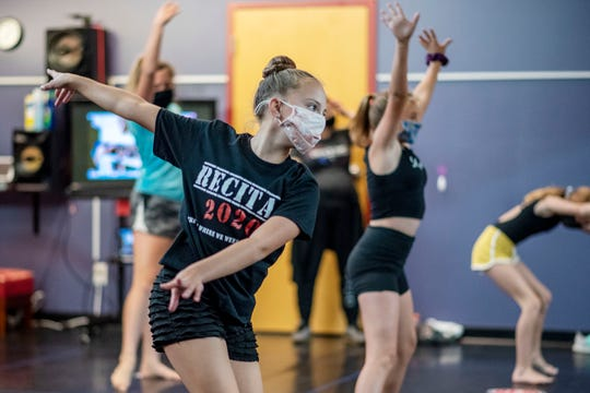Polly Loppnow, 12, wears a facemask to an acrobatic and improvisation class on Tuesday, Sept. 22, 2020 at Center Stage Dance Studio in Battle Creek, Mich.