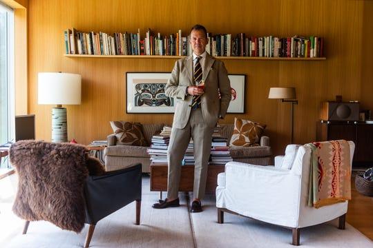 Matt Hranek in the living room of his home, a prefab design by anAustrian architect.