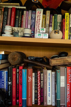 Cookbooks and knickknacks line bookshelves of magazine editor Matt Hranek's home.