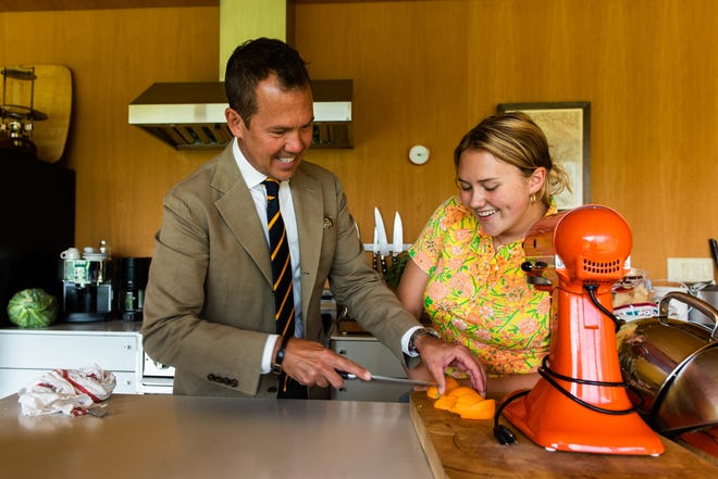 Matt Hranek and his daughter, Clara, cut an orange slice to garnish a Negroni.