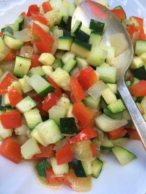 Zucchini Hash Browns contain onion and red bell pepper.
