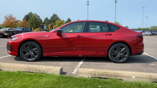 The 2021 Acura TLX's recognizable long nose and short rear deck.