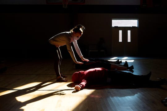 Yoga instructor Erin Rauscher wafts a scent of peppermint over Juan Mendoza as she leads the Southridge football team through yoga exercises at the Southridge High School field house in Huntingburg, Ind., Saturday morning, Sept. 19, 2020.