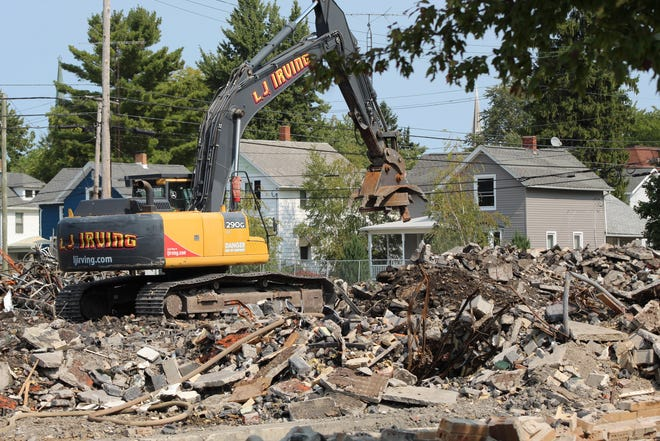 Demolition continued Tuesday on Fremont City Schools' old Hayes Elementary School building. L. J. Irving is razing the school building. Superintendent Jon Detwiler said demolition at the Hayes site should be completed by the end of September.