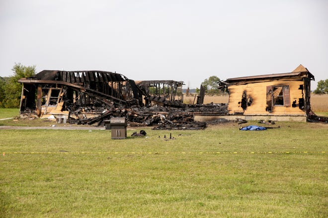 The charred structure of a house on the 2700 block of South Indiana 29, Wednesday, Sept. 23, 2020 in Carroll County. Officials say two people, a man and woman, were found dead inside the house, located north of Burlington. The woman, Anna Downham, 35, officials say had been killed before the fire started in the house.