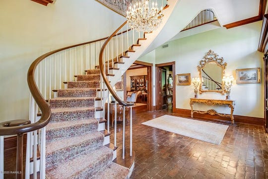 Inside, the two story foyer has a custom-made ''free standing spiral staircase'' with oak handrails and a Labarden custom-made chandelier.