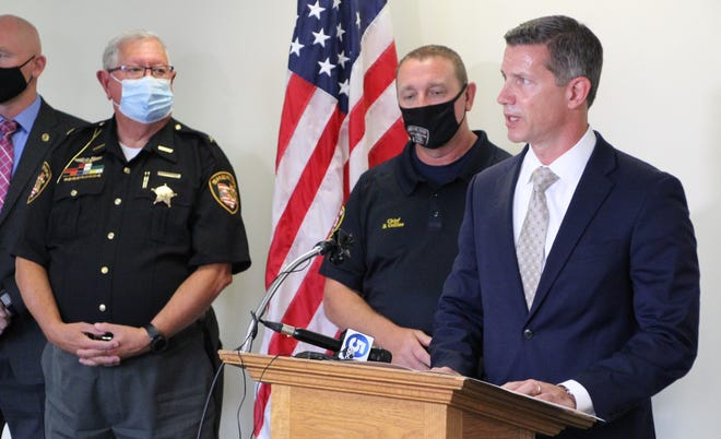 Marion County Sheriff Tim Bailey, left, and Marion Police Chief Bill Collins, center, listen as FBI Special Agent in Charge Eric B. Smith speaks during a press conference following the arrest of 43 alleged drug traffickers on Wednesday, Sept. 23, 2020, in Marion County. The arrest sweep on Wednesday ended a string of investigations into drug trafficking operations in Marion County that began in 2015, Smith said.