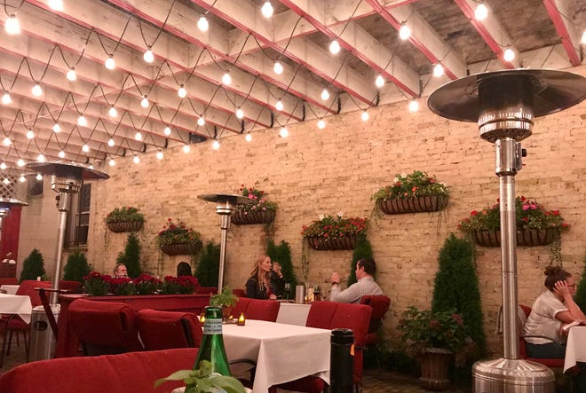 La Terrazza, the patio at Ristorante Bartolotta in Wauwatosa, has three walls keeping it cozy but is open at the front and overhead to supply fresh air.