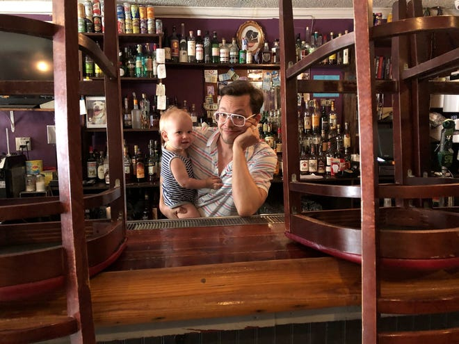 T. Cole Newton stands in his shuttered New Orleans bar Twelve Mile Limit with his son Felix. (Courtesy Twelve Mile Limit)