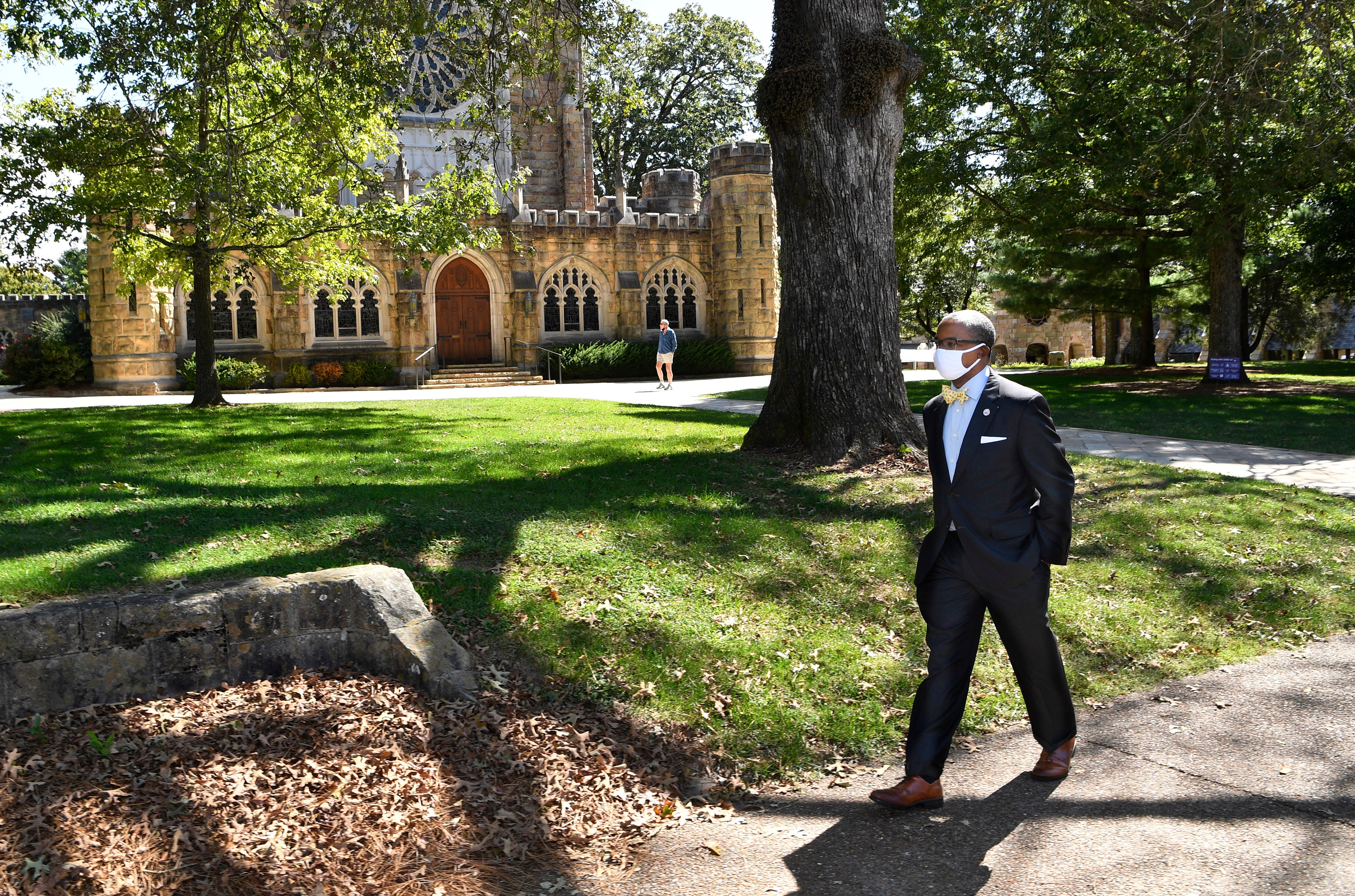 President and Vice-Chancellor Reuben E. Brigety II is the first African American to serve in that post. He walks past the most impressive building on campus, All Saints Chapel, at The University of the South in Sewanee, Tenn. Tuesday, Sept. 22, 2020.