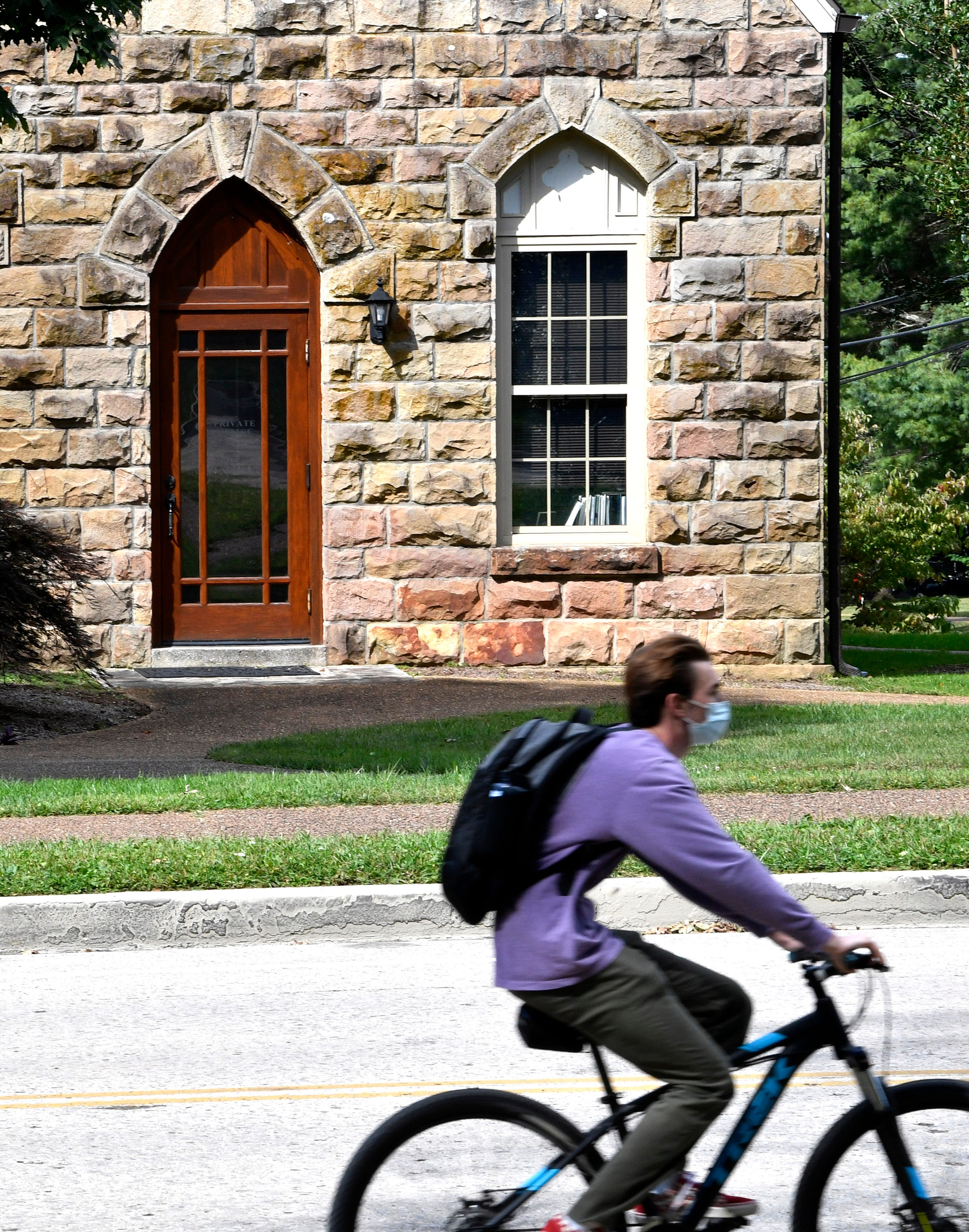 A student rides his bike past Thomson Union that was named for Jacob Thompson (1810-1885), inspector general for the Confederate States Army. Thompson was effectively the leader of the Confederate Secret Service, and is most well-known for a suspected meeting he may have had with Abraham Lincoln's assassin, John Wilkes Booth. Thompson was also a trustee of the University for twelve years. The building is already scheduled to be renamed to Biehl Commons in Sewanee, Tenn. Tuesday, Sept. 22, 2020.