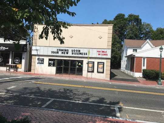 The Ramsey Theater on East Main Street has posted a for-sale sign on its marquee.