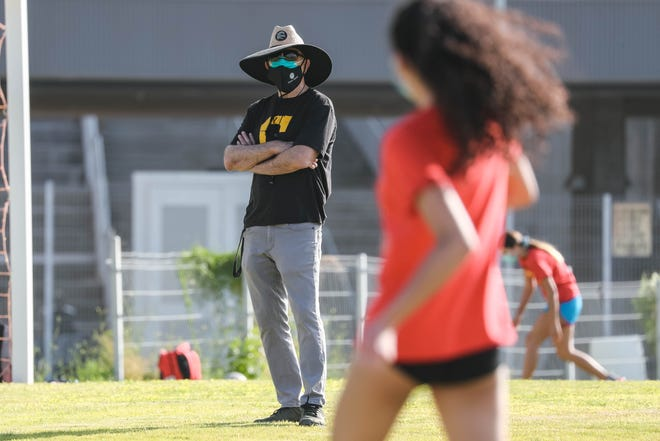 Head coach Al Rosen coaches as the varsity team runs plays at Centennial High School girl's volleyball practice in Las Cruces on Wednesday, Sept. 23, 2020.