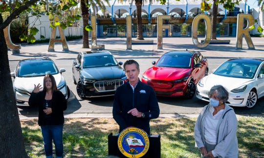 California Gov. Gavin Newsom announces an executive order on Sept. 23, 2020, that will have the state halt sales of new gasoline-powered passenger cars by 2035.  At right is California Air Resources Board Chair Mary Nichols.