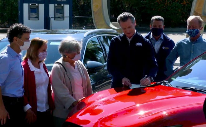 Gov. Gavin Newsom signs an executive order concerning electric vehicles on Sept. 23, 2020.