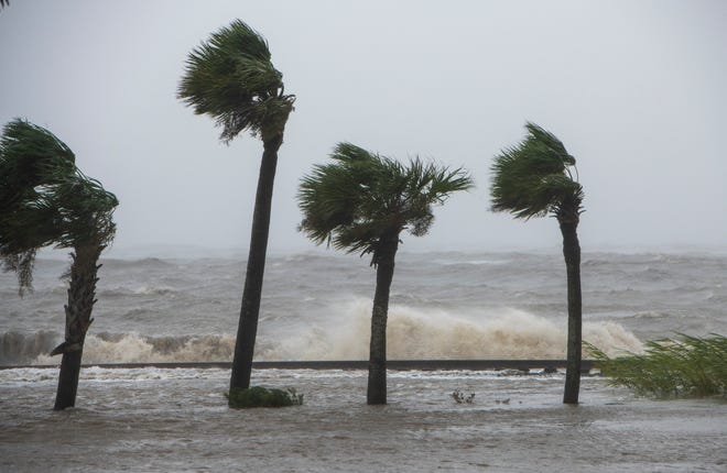Waves crash over the railroad tracks along Scenic Highway in Pensacola as Hurricane Sally passed through Sept. 16.