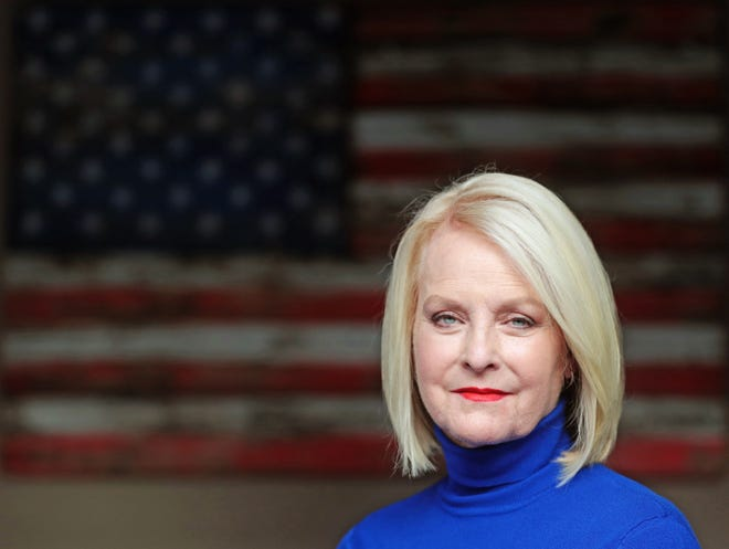 Cindy McCain sits on the patio at her home in Phoenix Sept. 22, 2020. The wife of the late Sen. John McCain (R-Ariz.) endorsed Democrat Joe Biden for president.