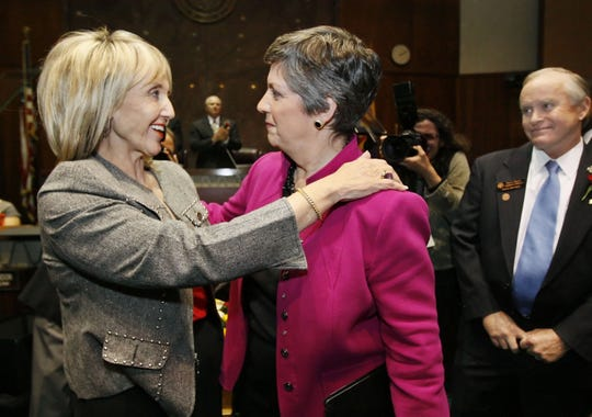 Jan Brewer, then the Secretary of State, hugs outgoing Governor Janet Napolitano after the governor gave her final State of the State address in 2009.