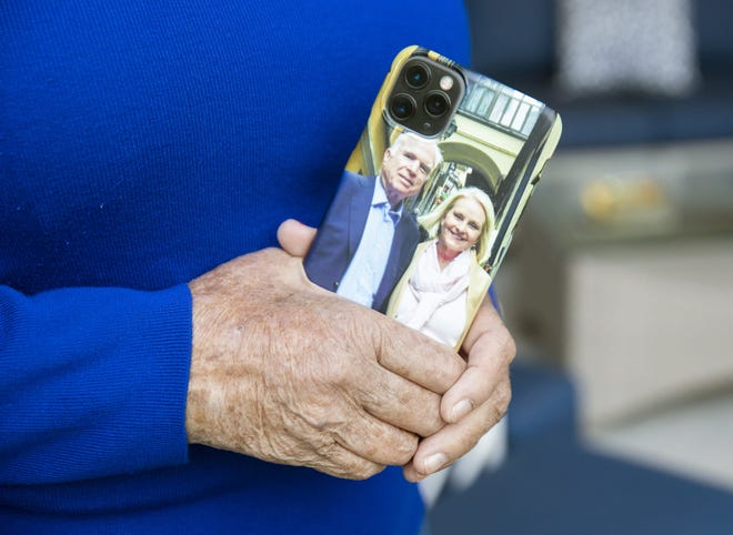 Cindy McCain holds her phone at her home in Phoenix Sept. 22, 2020. The phone case has a picture of her late husband, Sen. John McCain.