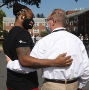 From left, Antuone Babb, SNUG case manager and Mayor Rob Rolison talk following the shooting response event at Corlies Manor Apartments in the City of Poughkeepsie on September 23, 2020.