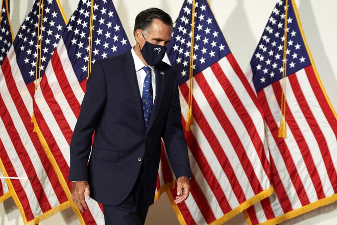 U.S. Sen. Mitt Romney (R-UT) arrives at the weekly Senate Republican policy luncheon at Hart Senate Office Building September 9, 2020 on Capitol Hill in Washington, DC. (Alex Wong/Getty Images/TNS)