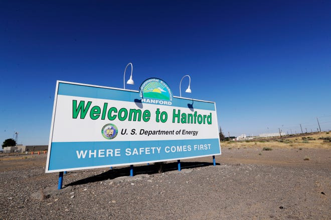 In this Aug. 13, 2019, file photo, a sign at the Hanford Nuclear Reservation is posted near Richland, Wash.