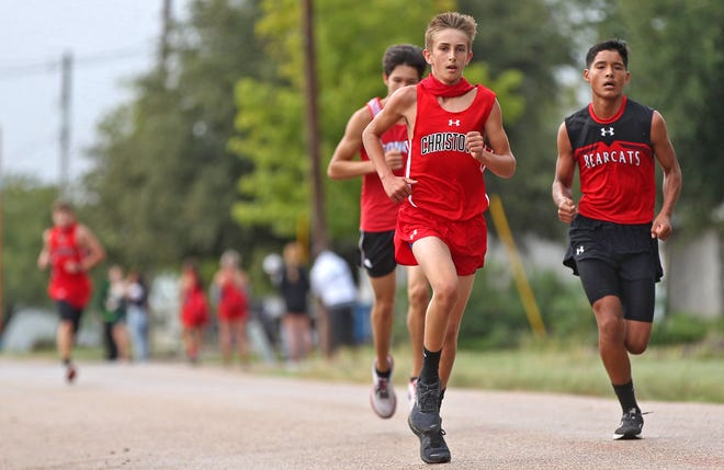 Runners compete in a cross country meet in Miles on Wednesday, Sept. 23, 2020.