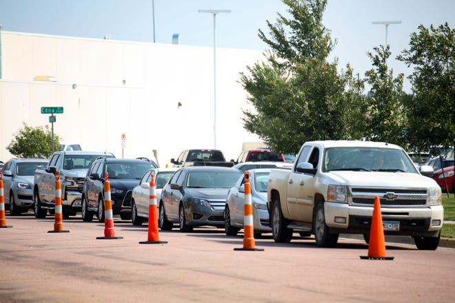 People wait in their vehicles for a COVID-19 test on Wednesday, September 23, at the Avera Family Health Center in Sioux Falls.