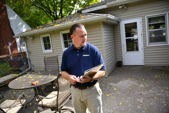 Jason Tangen of Shrewd Real Estate checks on details of a property with a homeowner during a listing appointment Tuesday, Sept. 22. 2020, in St. Cloud.
