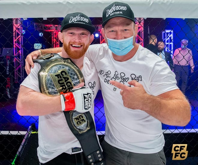 Becker native Bobby Lee celebrates winning the Cage Fury FC Interim Welterweight Championship with his coach Brock Larson Friday, Sept. 18, 2020, at the Horseshoe Tunica Hotel & Casino in Mississippi.
