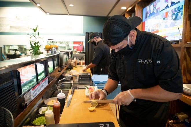 Chuck's Fish Head Sushi Chef Jovan Bills prepares a roll at the restaurant Tuesday, Sept. 22, 2020.