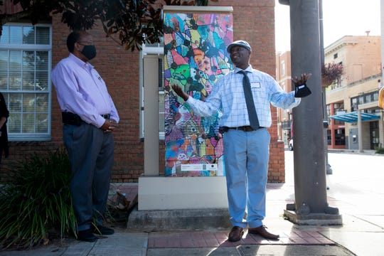 "Christopher Barnhart, the artist who created the Art of the Box traffic control box mural on the corner of East College Avenue and Adams Street downtown, talks about his inspiration for the piece titled ""Infinite Possibilities"" after it was revealed Wednesday, Sept. 23, 2020."