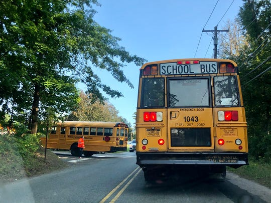 Cars and buses lined up to drop off students at Brookside Elementary school on Tuesday September 22. The wait for kids to have their health screened pushes traffic back off the schools campus, down Broad Street and even onto Saw Mill River Rd in Yorktown.