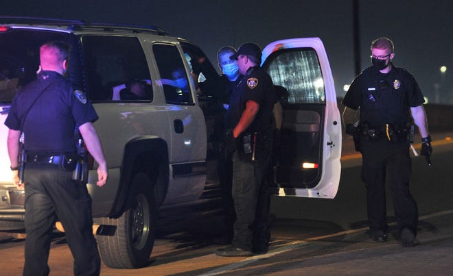 Wichita Falls police investigate a report of a vehicle involved in shots fired call near downtown Tuesday night.