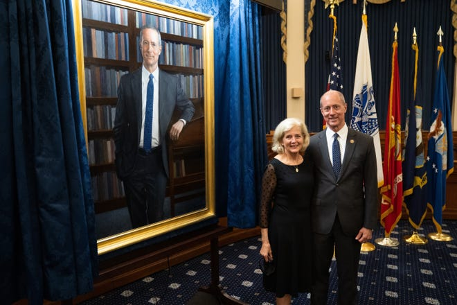 U.S. Rep. Mac Thornberry and his wife, Sally, stand beside his portrait, which is destined for the main meeting room of the House Armed Services Committee.