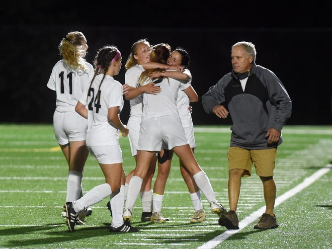 River View players celebrate after time runs out in a 1-0 win against host John Glenn earlier this season. The Lady Bears earned the top seed in Division II, as the East District held tournament draws for soccer and volleyball on Sunday.