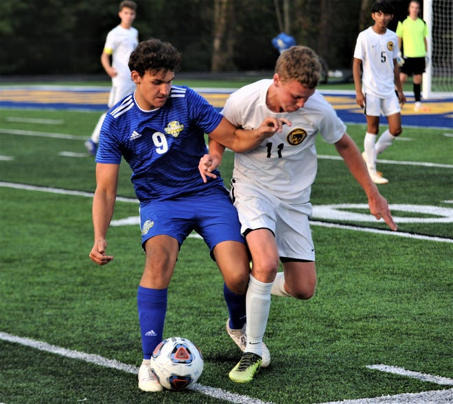 West Muskingum's Luke Pattison battles for possession against Tri-Valley's Josey Boyd in Tuesday's match. West M won 1-0 to stay unbeaten.