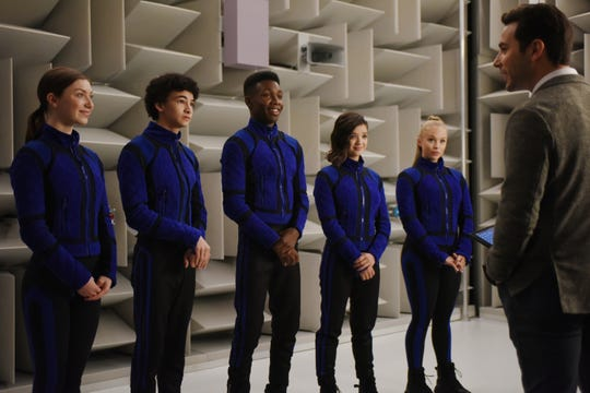 """Skylar Astin (far right) stars as the professorial leader of a group of teen superheroes (Isabella Blake-Thomas, Faly Rakotohavana, Niles Fitch, Peyton Elizabeth Lee and Olivia Deeble) in the Disney+ fantasy adventure """"The Secret Society of Second-Born Royals."""""""