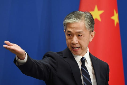 Chinese Foreign Ministry spokesman Wang Wenbin takes a question during the daily Foreign Ministry briefing in Beijing on July 24, 2020. China on July 24 ordered the US consulate in the southwestern city of Chengdu to close in retaliation for one of its missions in the United States being shuttered, capping a furious week of Cold War-style diplomacy.