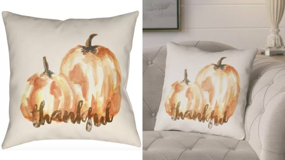 This fall-themed pillow works well indoors or outdoors.