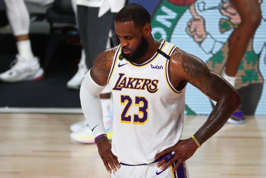 LeBron James reflects during the second half of the Lakers' Game 3 loss to the Nuggets.