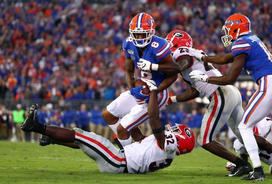 Florida wide receiver Trevon Grimes is tackled by Georgia linebacker Monty Rice during the second half of their 2019 game at TIAA Bank Field in Jacksonville, Florida.