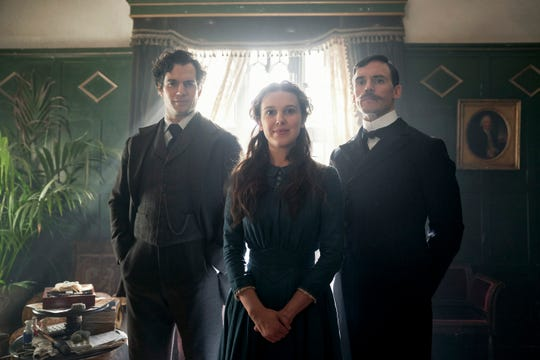 """Teenage Enola Holmes (Millie Bobby Brown) reconnects with her brothers Sherlock (Henry Cavill) and Mycroft (Sam Claflin) in the Netflix action-adventure """"Enola Holmes."""""""