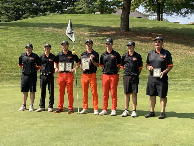 Members of the Ashland High boys golf team pose for a picture after winning the Ohio Cardinal Conference Championships Thursday at Mohican Hills Golf Course.