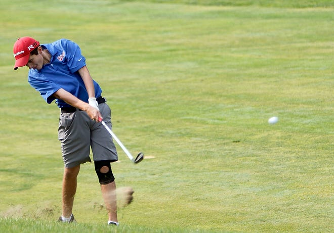 West Holmes' Hunter Ellis hits a shot on hole No. 18 during the Ohio Cardinal Conference Championships Thursday at Mohican Hills Golf Club.