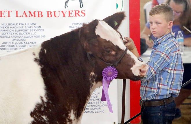 Carston Stephens had the grand champion in Sunday's Junior Fair Market Steer Show at the Ashland County Fair.