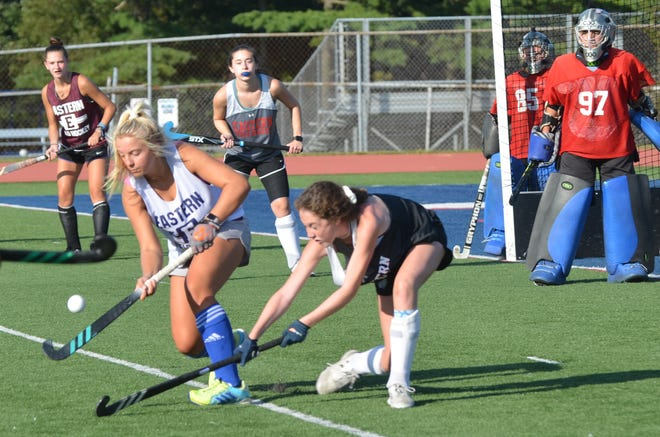 Eastern field hockey junior Ryleigh Heck air dribbles during a drill at preseason practice